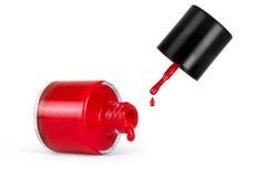Bouteille rouge de vernis à ongles avec l'éclaboussure d'isolement sur le blanc Photographie stock