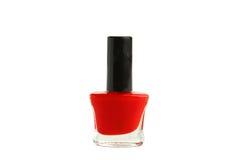 Bouteille rouge de vernis à ongles d'isolement sur le blanc Photo libre de droits