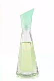 Bouteille verte de parfum sur un fond blanc Images libres de droits