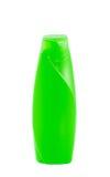 Bouteille verte de shampooing d'isolement sur le blanc Image libre de droits