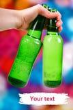 Bouteille verte. fond de disco Images stock