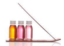 Bouteilles avec les huiles essentielles Photos stock