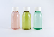 Bouteilles avec les liquides colorés Images stock