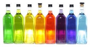 Bouteilles colorées lumineuses Photographie stock libre de droits