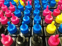 Bouteilles d'encre de CMYK pour l'imprimante Image stock