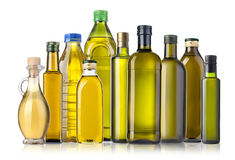 Bouteilles d'huile d'olive sur le blanc Image libre de droits