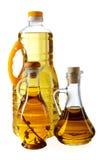 Bouteilles d'huile et de tournesol d'olive Photos stock