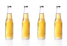 Bouteilles de bière d'isolement sur le blanc Photo libre de droits