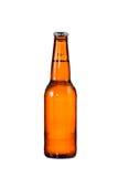 Bouteilles de bière sur le fond blanc Photographie stock libre de droits