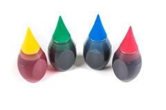 4 bouteilles de colorant alimentaire Photo libre de droits