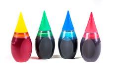 4 bouteilles de colorant alimentaire Image libre de droits
