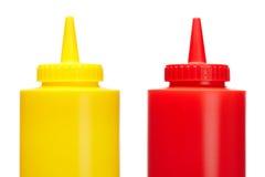 Bouteilles de ketchup et de moutarde Photographie stock