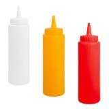 Bouteilles de moutarde, de ketchup et de mayonnaise Image stock