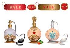 Bouteilles de parfum avec des labels de vente Image stock