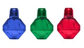 Bouteilles de parfum en verre octogonales colorées, ou modèle de diamant d'isolement sur le fond blanc Photo libre de droits