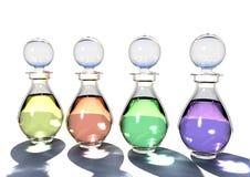 Bouteilles en verre avec les pétroles colorés Photographie stock