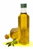 Bouteilles et chocs avec l'huile d'olive Photos libres de droits