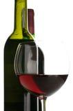 Bouteilles et glace de vin rouge Image libre de droits