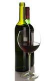Bouteilles et glace de vin rouge Photos stock