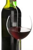 Bouteilles et glace de vin rouge Images stock