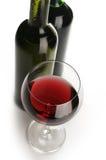 Bouteilles et glace de vin rouge Photographie stock