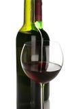 Bouteilles et glace de vin rouge Image stock