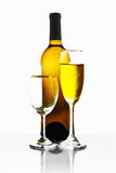 Bouteilles et glaces de vin Photo stock