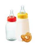 Bouteilles et simulacre à lait de bébé Photographie stock