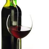 Bouteilles et verre de vin rouge Photo libre de droits