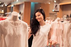 Boutique. Asian beautiful woman shopping in the boutique Royalty Free Stock Photos