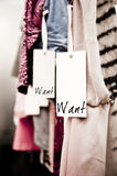 Boutique clothes, want!. Tight crop of clothes in a boutique with a tag reading want Stock Image
