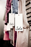 Boutique clothing rack with Sale tag royalty free stock photo