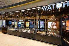 Boutique con franquicia del reloj, aeropuerto Suvarnabhumi de Bangkok Imágenes de archivo libres de regalías
