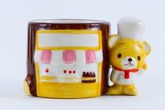 Boutique de boulangerie et chef d'ours Photos stock
