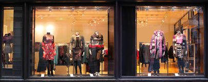 Boutique with dressed mannequins Stock Photo