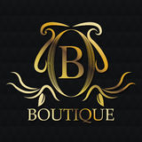 Boutique gold emblem design Stock Images
