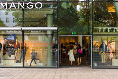 Boutique at MANGO Kurfuerstendamm. BERLIN - AUGUST 03: Boutique at MANGO Kurfuerstendamm. MANGO, is a clothing design and manufacturing company with annual Royalty Free Stock Images
