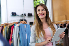 Boutique owner using a digital tablet Royalty Free Stock Image
