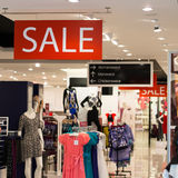 Boutique sale. Fashion boutique sale in woman clothing inside shopping mall Royalty Free Stock Image