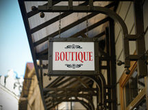 Boutique shop sign. In a city center Stock Photo