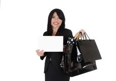 Boutique shopper holding up a sign Royalty Free Stock Images