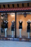 Boutique window. With dressed mannequins in shopping mall Stock Photo