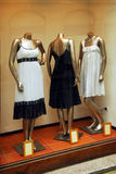 Boutique window. Boutique display window with mannequins in fashionable dresses Stock Images