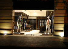 Boutique window with dressed mannequins Royalty Free Stock Photo