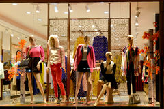 Boutique window,Fashion clothing store,Fashion store window in shopping mall,dress shop window taken at night Stock Images