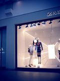 Boutique Zara at Mall, with mannequins and dresses with stripes. Stock Photography