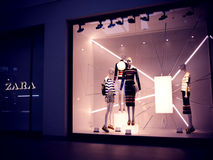 Boutique Zara at Mall, with mannequins and dresses with stripes. Stock Image