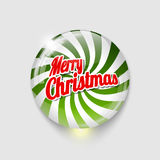 Bouton brillant avec le Joyeux Noël de spirale et de textes Photo libre de droits
