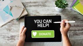 Bouton d'aide et de donation sur l'?cran de dispositif photos stock