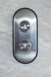 Bouton d'ascenseur à travers la direction Photographie stock libre de droits